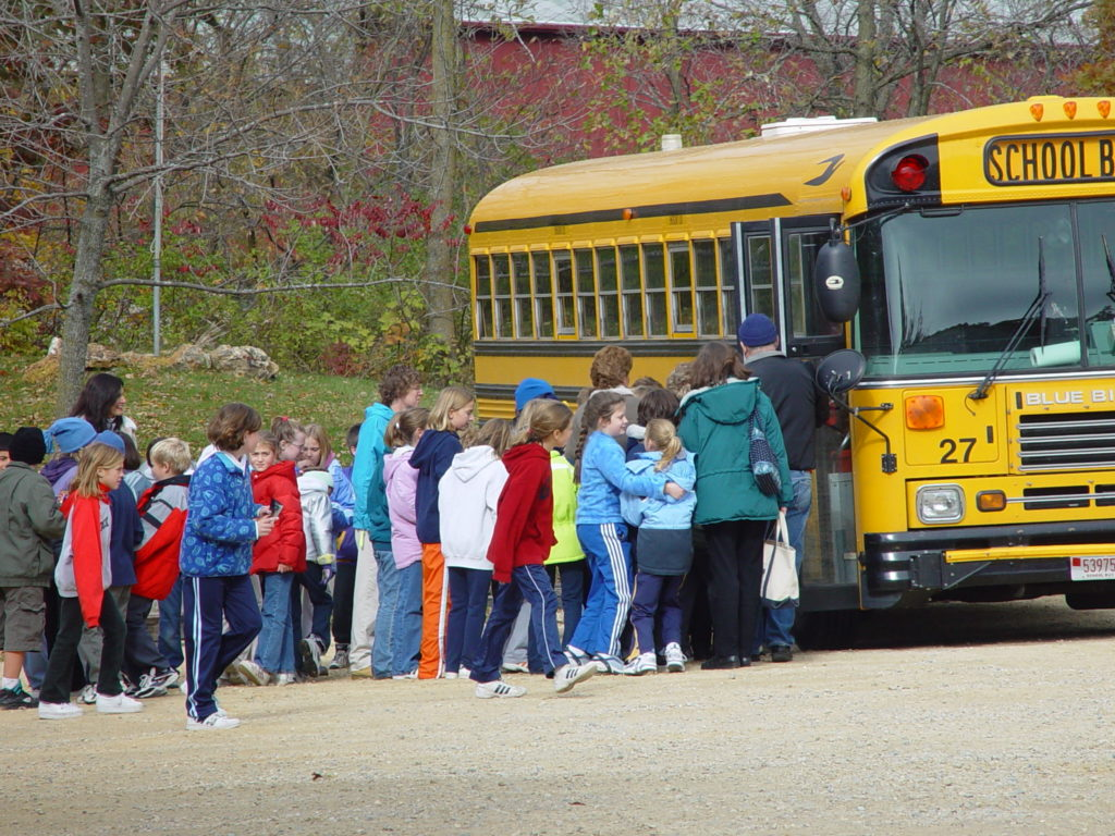 Photo of school group loading onto the bus