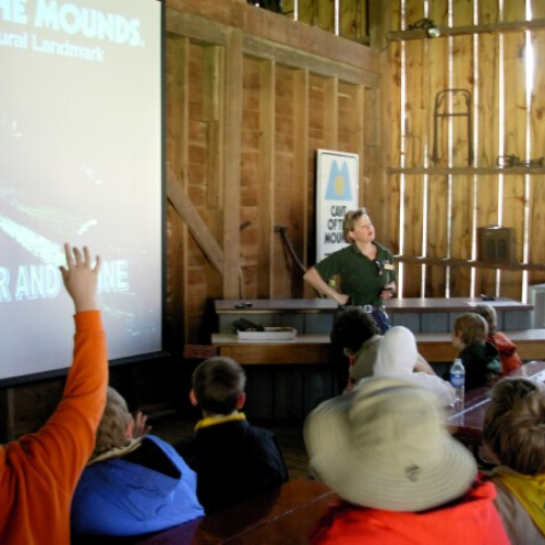 Photo of a tour guide teaching a school group