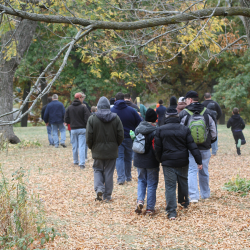Photo of group taking a hike on our trails in the fall