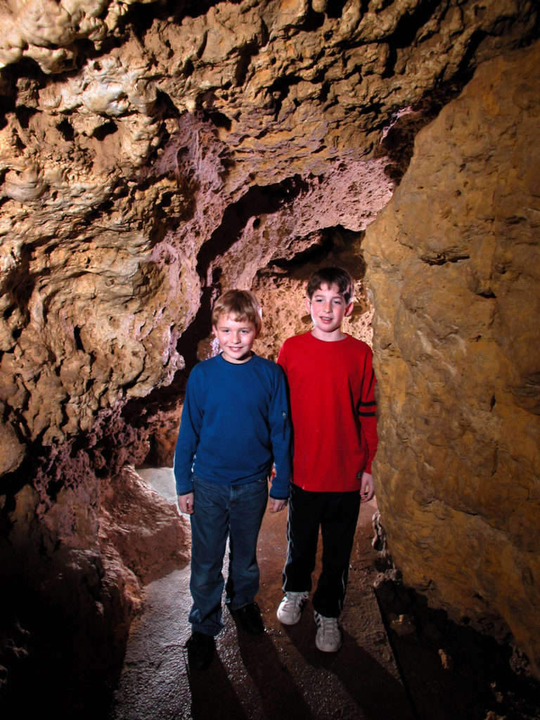 Photo of Kids in the Meanders of the cave Walking