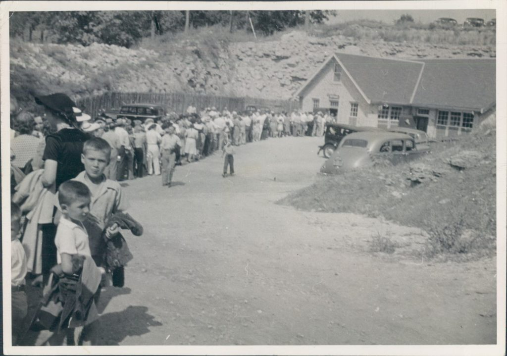 Vintage Photo of the Cave Entrance Building with a long line of people in the 1940s