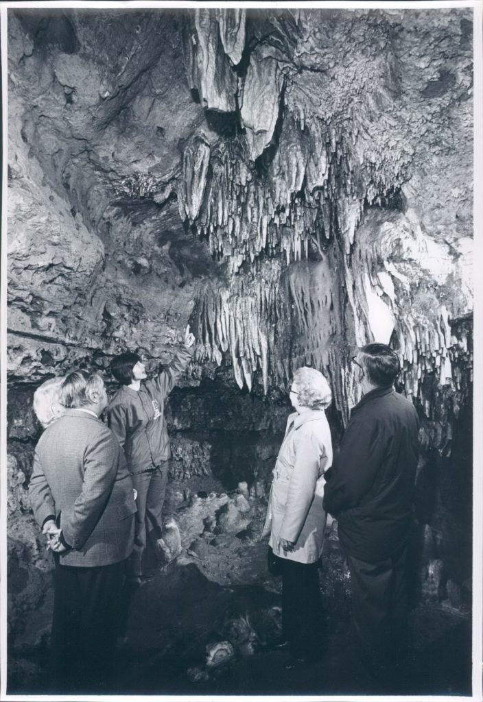 Vintage Photo of the some Guests with a Tour Guide in Cathedral Room inside the cave.