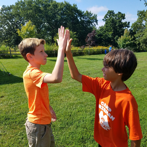 Photo of kids high fiving