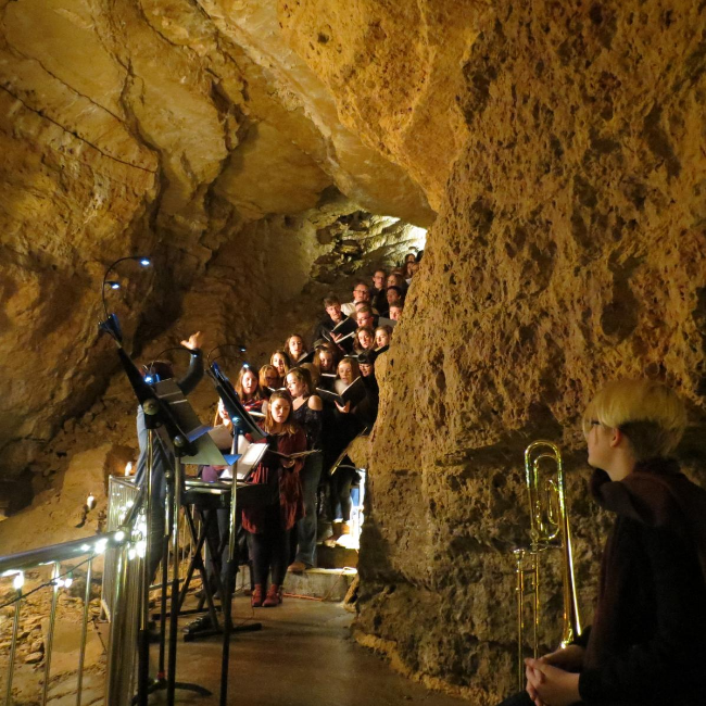 Photo of Choir singing in Cave of the Mounds