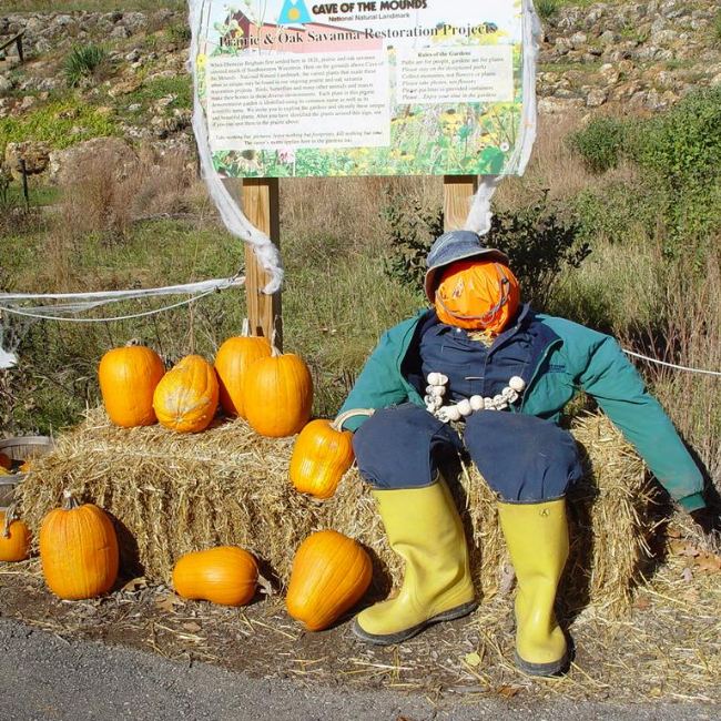 Photo of Cave of the Mounds Holloween Event with a man filled with hay and a pumpkin head