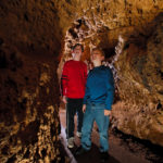 Photo of Kids in the Meanders of the cave looking around.
