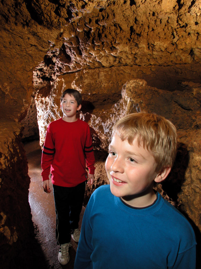 Photo of Kids in the Meanders of the Cave closerup