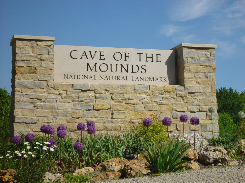 Photo of our Entrance Sign with purple flowers