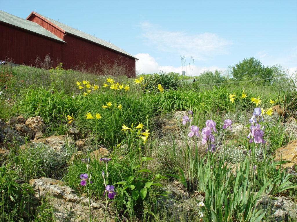 Photo of Grounds and Gardens with Flowers with a Barn